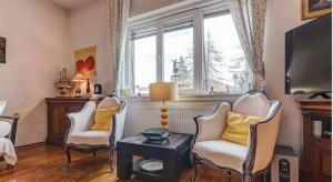 two armchairs, coffe table and window in stylish apartment