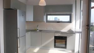 Kitchen with stove, fridge and sink