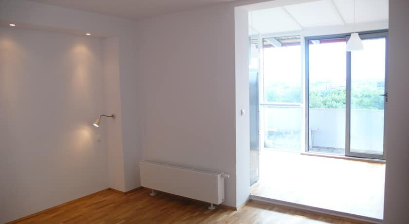 empty living room with exit to balcony