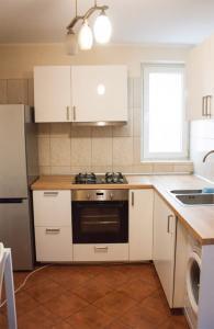 white kitchen with a fridge