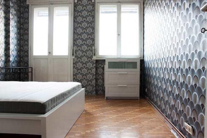 bedroom with grey wallpaper